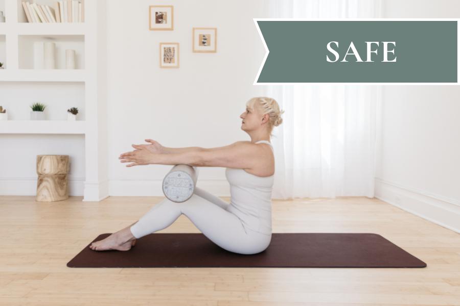 A woman demonstrates a modified diastasis recti-safe pilates pose.